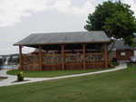 View larger image of Patio area with picnic table at ALAMO FIESTA RV RESORT image #4