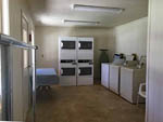 View larger image of The clean coin operated laundry room at BAUERS CANYON RANCH RV PARK image #4
