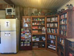 View larger image of The fully stocked library at BAUERS CANYON RANCH RV PARK image #5