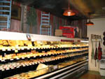 View larger image of Meats cheeses and breads at deli at COUNTRY GARDENS RV PARK image #8