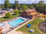 View larger image of An aerial view of the pool area and main building at PETOSKEY KOA image #3