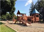 View larger image of Sand playground with wooden swing set at COEUR DALENE RV RESORT image #8