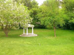 View larger image of Small white gazebo on green scenery at RV RESORT FOUR SEASONS image #4