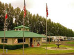 View larger image of Flag poles at campground at RV RESORT FOUR SEASONS image #5