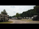 View larger image of Multiple RV units parked at camping spots at OUTDOOR LIVING CENTER RV PARK image #2