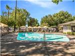 View larger image of Swimming pool with outdoor seating at WALNUT RV PARK image #6
