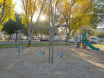 View larger image of Playground with swing set at VALENCIA TRAVEL VILLAGE image #3
