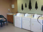 View larger image of Interior of laundry room with 3 washers at VICTORIAN RV PARK image #6