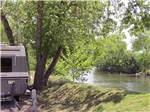 View larger image of RVs camping on the water at RIPPLIN WATERS CAMPGROUND  CABIN RENTAL image #9