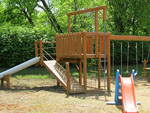 View larger image of Playground with swing set at RIPPLIN WATERS CAMPGROUND  CABIN RENTAL image #11