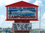 View larger image of Sign at entrance to RV park at RIPPLIN WATERS CAMPGROUND  CABIN RENTAL image #12