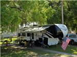 View larger image of Trailer camping at PIONEER VILLAGE RV RESORT image #1