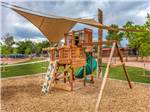 View larger image of Playground with swing set at ARCHVIEW RV PARK  CAMPGROUND image #6
