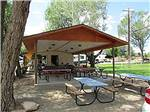 View larger image of Patio area with picnic tables at SUNDANCE RV PARK image #6