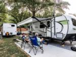 View larger image of Swimming pool with outdoor seating at CREEKSIDE RV PARK image #8