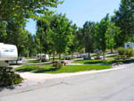 View larger image of Picnic tables and trailers camping at MOUNTAIN GATE RV PARK image #3