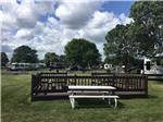 View larger image of Staff member disinfecting the poker chips at a table at GRAND HINCKLEY RV RESORT image #9