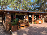 View larger image of Outside of the Outfitter Shop at CAMP MACK A GUY HARVEY LODGE MARINA  RV RESORT image #2