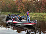 View larger image of A group of bass boats on the water at CAMP MACK A GUY HARVEY LODGE MARINA  RV RESORT image #3