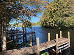 View larger image of Some of the wooded docks at CAMP MACK A GUY HARVEY LODGE MARINA  RV RESORT image #4