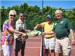 View larger image of Couples playing pickleball at GOOD LIFE RV RESORT image #2