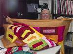 View larger image of Woman quilting at APACHE WELLS RV RESORT image #9