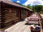 View larger image of Lodging with deck and picnic tables at ELK MEADOW LODGE AND RV RESORT image #5