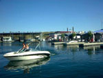 View larger image of Couple boating at PLEASANT HARBOR MARINA  RV RESORT image #1