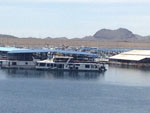 View larger image of Houseboat along river at PLEASANT HARBOR MARINA  RV RESORT image #9