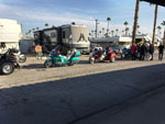 View larger image of Trailers and RVs camping with motorcycles at DESERT HOLIDAY RV RESORT image #5