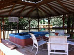 View larger image of Covered Hot tub deck with table and chairs at TWIN OAKS RV PARK image #5
