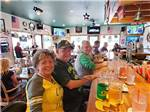 View larger image of Interior of cafe with patrons at OSPREY POINT RV RESORT image #3