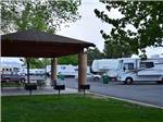 View larger image of Patio and RVs and trailers at SILVER SAGE RV PARK image #1