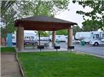 View larger image of BBQ pits beside covered patio area park at SILVER SAGE RV PARK image #7
