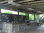 View larger image of Patio area with picnic table at STONE CREEK RV PARK image #8