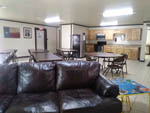 View larger image of Interior kitchen area with sofa tables and chairs at STONE CREEK RV PARK image #9