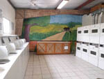 View larger image of Laundry room with landscape mural at STONE CREEK RV PARK image #10