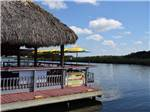 View larger image of Patrons conversing under covered patio area at NATURES RESORT image #7