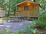 View larger image of Log cabin with deck at HO-CHUNK RV RESORT  CAMPGROUND image #5