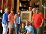 View larger image of Group photo of people in large lodge at COZY ACRES CAMPGROUNDRV PARK image #4