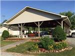 View larger image of Patio area with picnic tables at KINGS HOLLY HAVEN RV PARK image #2