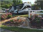 View larger image of RVs and trailers at campground at KINGS HOLLY HAVEN RV PARK image #5