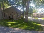 View larger image of View of office building and shade trees at SPRING LAKE RV RESORT image #9