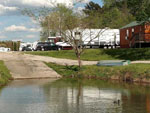 View larger image of Trailers and RVs camping on the water at YOUNGS LAKESHORE RV RESORT image #2