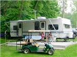 View larger image of Golf cart parked by a trailer at LAKE RUDOLPH CAMPGROUND  RV RESORT image #9