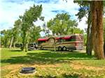 View larger image of A Class A motorhome parked in an RV site at THE LONGHORN RANCH LODGE AND RV RESORT image #7