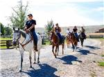 View larger image of People riding on horses at THE LONGHORN RANCH LODGE AND RV RESORT image #9