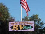 View larger image of Park sign with American flag at FAIR HARBOR RV PARK image #12