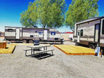View larger image of Picnic tables and trailers camping at CANYON GATEWAY RV PARK image #5