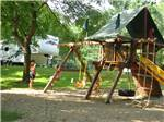 View larger image of Playground with swing set at AUSTIN LAKE RV PARK  CABINS image #2